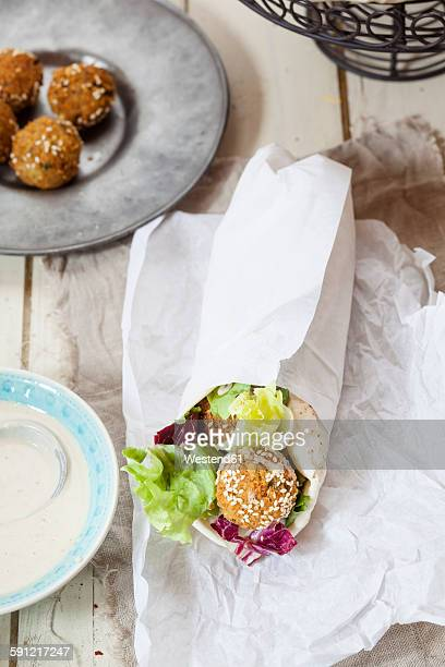 Homemade falafel with lettuce, tahini sauce in flat bread, Dueruem