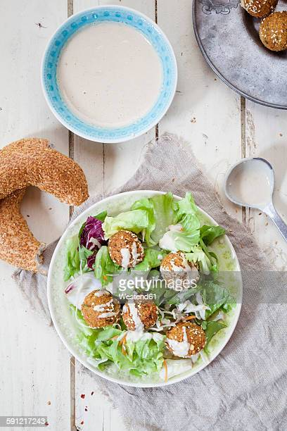 Homemade falafel with salad, tahini sauce on plate