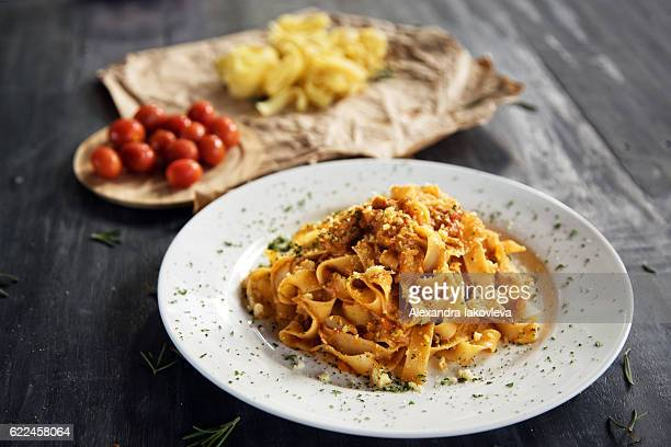 Homemade fettuccine pasta with bolognese sauce