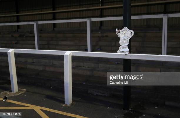 A homemade foil FA Cup trophy is left on the terraces after the FA Cup Third Round match between Woking and Watford at Kingfield Stadium on January 6...