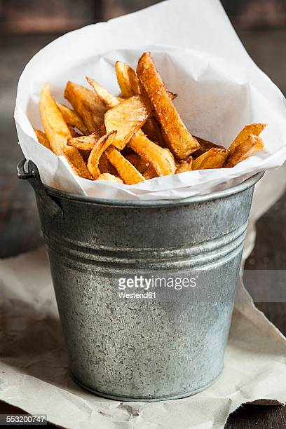 Homemade french fries in tin bucket