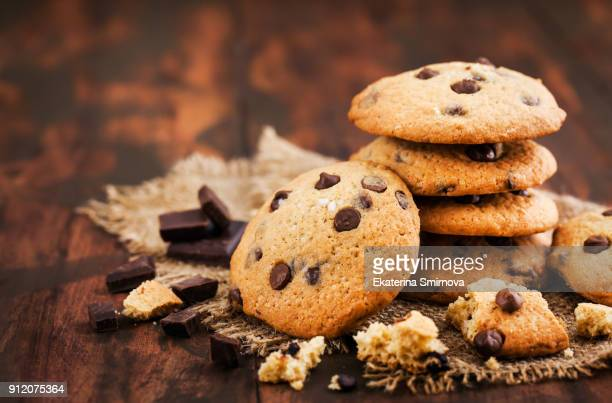 homemade freshly baked chocolate chips cookies - biscuit stock photos and pictures