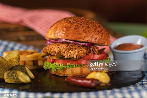homemade fried chicken burger - crunchy stock pictures, royalty-free photos & images