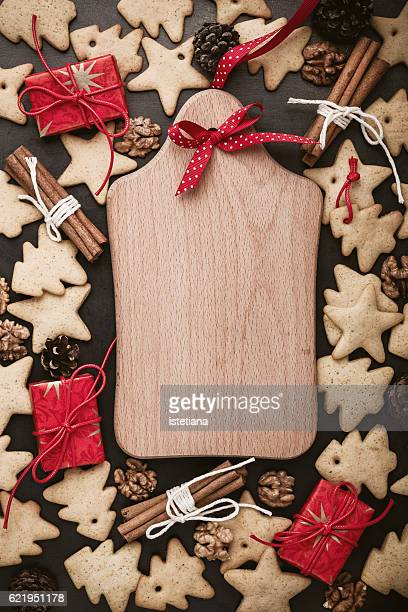 Homemade gingerbread cookies and cutting board with copy space