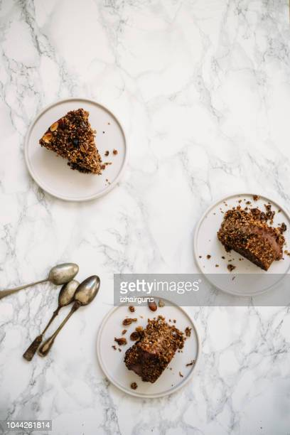 homemade gluten free, vegetarian сarrot, banana and nuts cake - serving size stock photos and pictures
