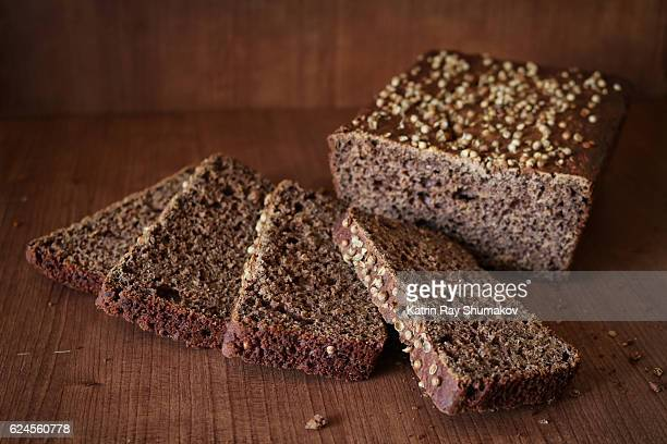 homemade gluten-free dark brown bread - millet stock pictures, royalty-free photos & images