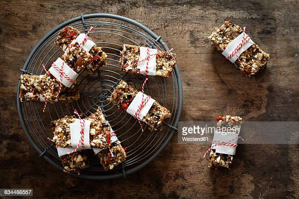 Homemade glutenfree, vegan granola bars on cooling grid and wood