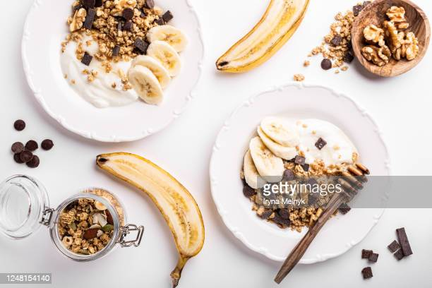 homemade granola on black plate - granola stock pictures, royalty-free photos & images