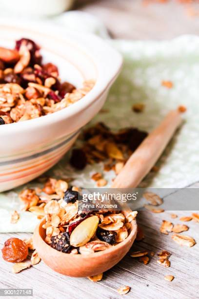 Homemade granola or muesli with toasted almonds, raisin, cranberry in a bowl for healthy breakfast, selective focus