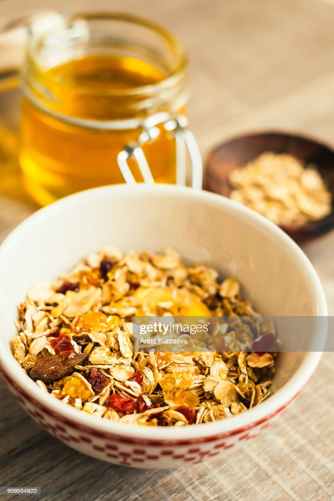 Homemade granola or muesli with toasted almonds, raisin, cranberry in a bowl for healthy breakfast, selective focus : Stock-Foto