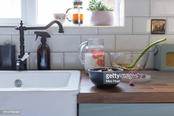 homemade granola with almond milk in the kitchen - granola stock pictures, royalty-free photos & images