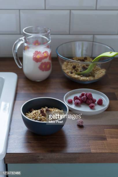 homemade granola with almond milk in the kitchen - kildare stock pictures, royalty-free photos & images