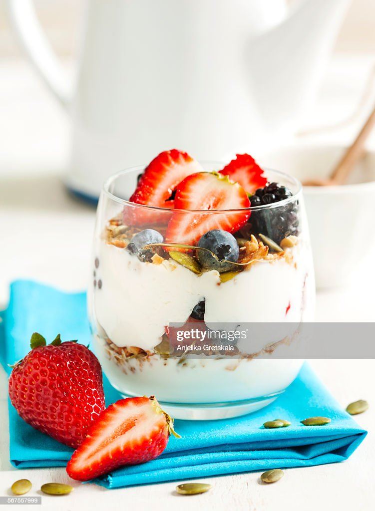 Homemade granola with yogurt, berry and honey : Stock Photo