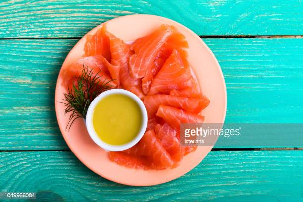 Homemade gravlax, salmon dish served with mustard sauce