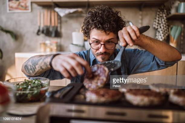 homemade hamburgers on electric grill - chef stock pictures, royalty-free photos & images