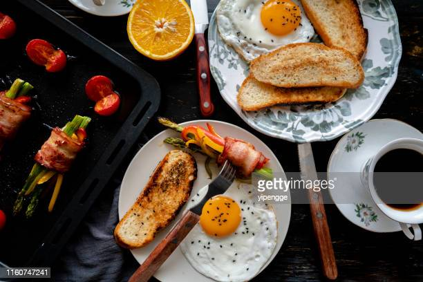 homemade healthy breakfast: toast, fried egg, bacon roll and coffee - food state stock pictures, royalty-free photos & images