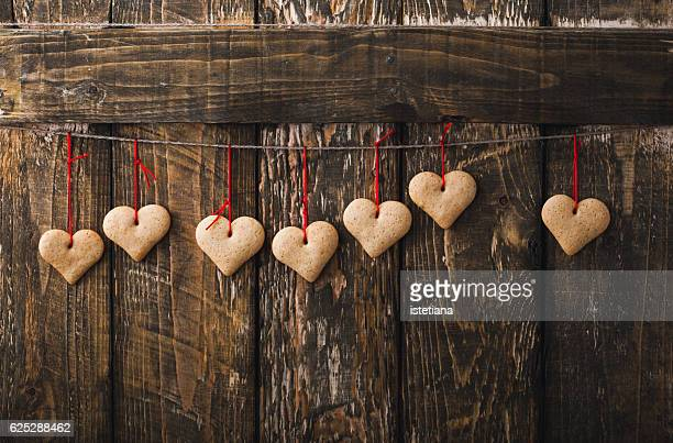 Homemade heart cookies on old wooden background