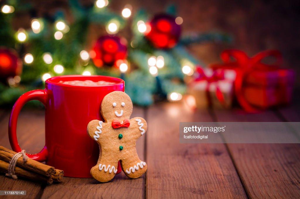 Homemade hot chocolate mug and gingerbread cookie on Christmas table : Stock Photo