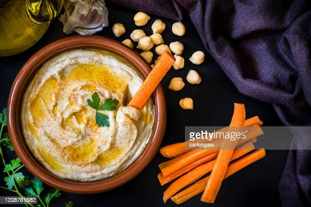 homemade hummus with carrot sticks - lebanon country stock pictures, royalty-free photos & images