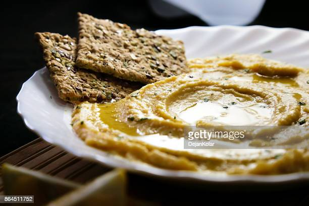 Homemade hummus with lemon, herbs, virgin olive oil and integral flatbread