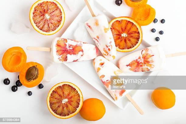 Homemade ice pops with fresh sicilian blood orange and apricot, top view