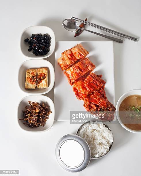 Homemade Kimchi with Traditional Korean Side Dishes Including Rice
