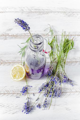 Homemade lavender lemonade with lemon in a bottle - gettyimageskorea