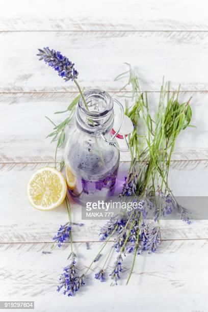Homemade lavender lemonade with lemon in a bottle