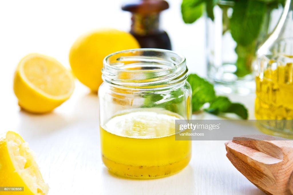 Homemade Lemon vinaigrette by fresh ingredients : Stock Photo