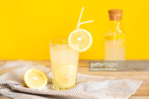 homemade lemonade in mason jars with big green paper straw - lemon soda stock pictures, royalty-free photos & images
