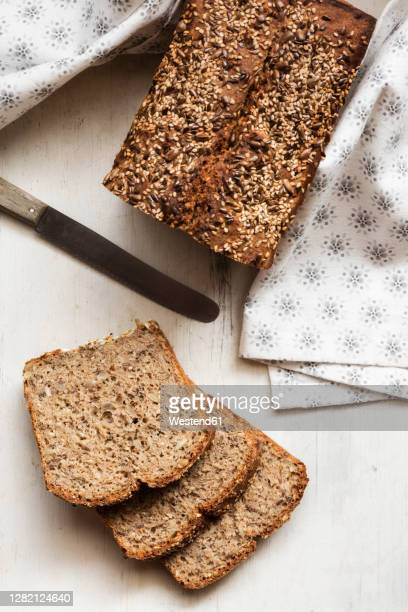 homemade loaf of buckwheat bread kept on cutting board - buckwheat stock pictures, royalty-free photos & images