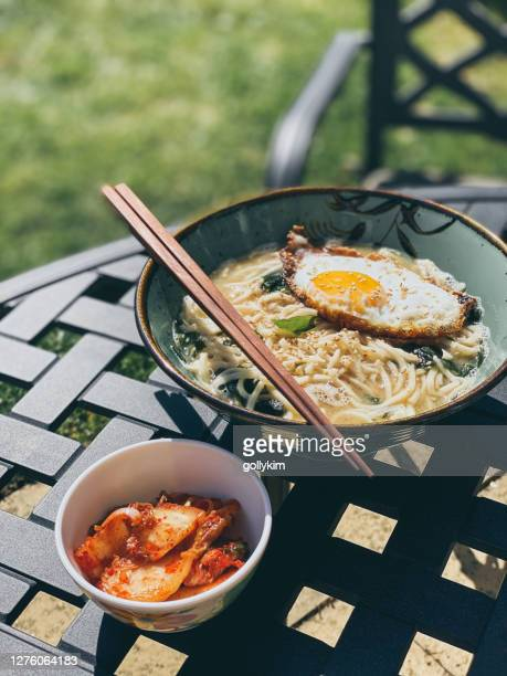 homemade miso ramen with fried egg and kimchi on the side - vegetarian food stock pictures, royalty-free photos & images