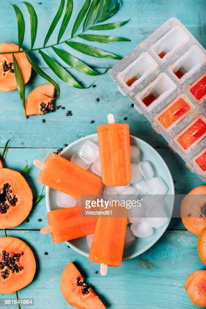homemade papaya ice lollies - papaya stock photos and pictures