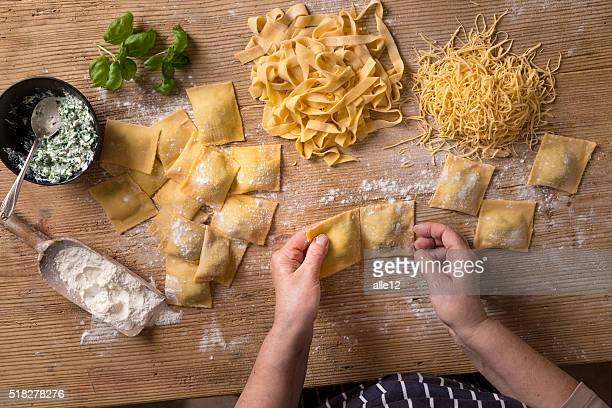homemade pasta - preparation stock pictures, royalty-free photos & images