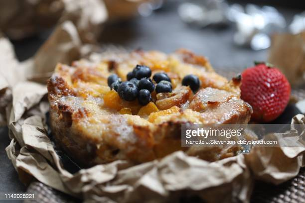 homemade peach bread pudding - nanette j stevenson stock photos and pictures