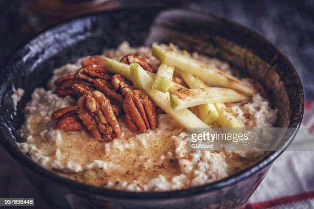 homemade pecan porridge with pears - oatmeal stock pictures, royalty-free photos & images