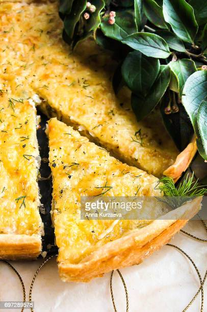 Homemade pie or quiche with white cabbage and apples, selective focus