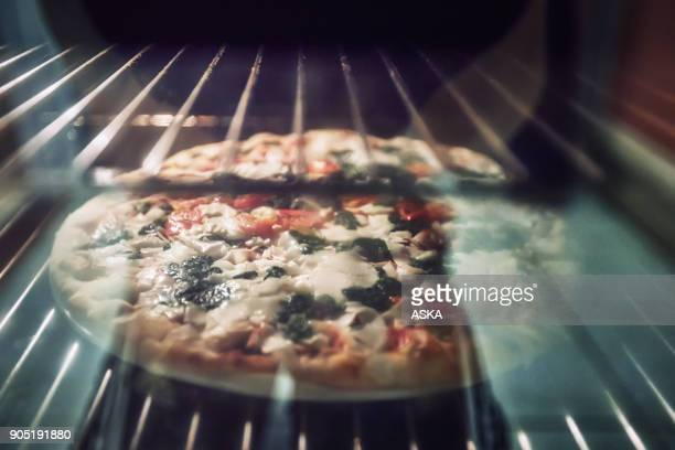 Homemade pizza is baked in a modern electric oven