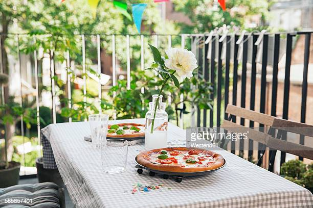 Homemade pizza on a laid table