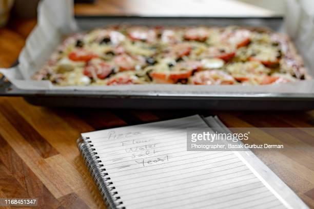 homemade pizza recipe - basak gurbuz derman stock photos and pictures