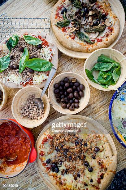 homemade pizzas and ingredients