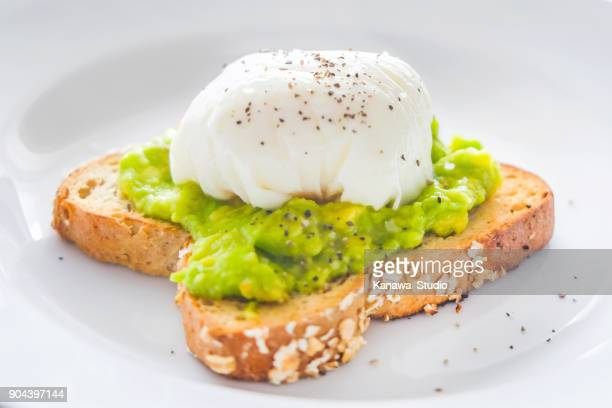 Homemade poached eggs with smashed avocado