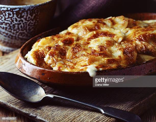 Home-made potato gratin in vintage dish