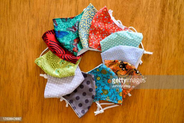 homemade protective face masks with colourful fabrics - craft stock pictures, royalty-free photos & images