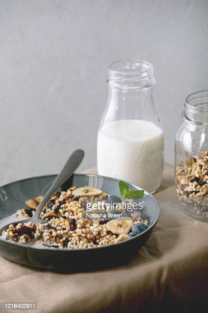 homemade puffed millet granola - millet stock pictures, royalty-free photos & images