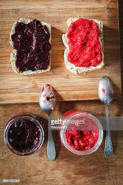 Homemade raspberry and blackberry jam with chia seeds, slices of bread
