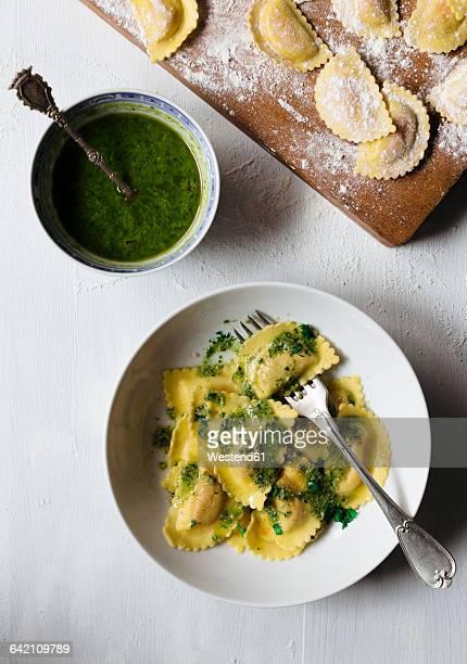 Homemade ravioli with pesto