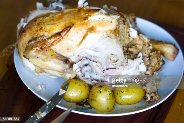 Homemade roasted and stuffed organic chicken with new potatos