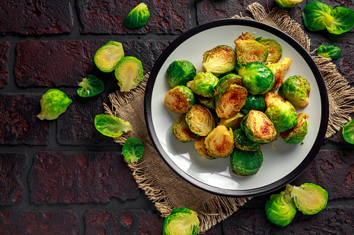 Homemade Roasted Brussel Sprouts with Salt, Pepper on a old stone rustic table 930776788