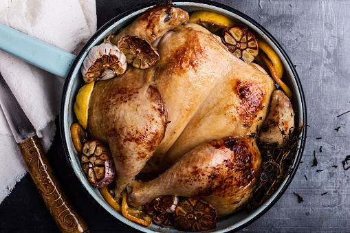 Homemade roasted chicken with spices, thyme and lemon - gettyimageskorea